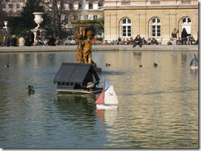 duck boats and fountain at palais de luxumbourg