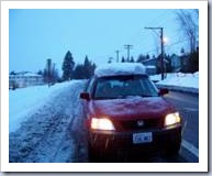 Honda CRV, covered with snow, heading to Canada